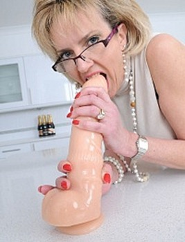 lady-sonia-sucking-a-huge-dildo